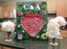 "Initial ""I Love You"" floral board and tissue peony topiaries to accessorize  the kitchen area. Board is covered with tiny flowers creating the heart."