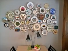 For six months I collected souvenir plates, ashtrays, and trivets from thrift stores to create my kitschy wall of plates in our little dining area. Total cost was about $40.