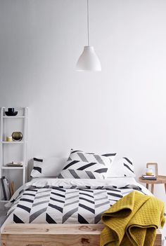 minimalist neutral chevron bedding in a modern bedroom
