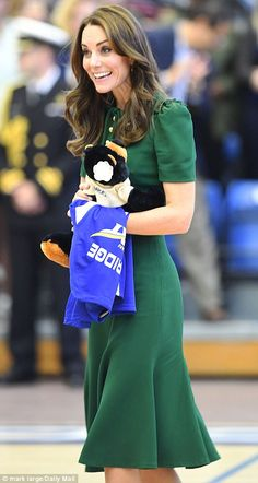 The couple were later handed soft toys wearing the university's colours, believed to be presents for George and Charlotte
