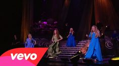 Celtic Woman - Níl Sé'n Lá (Live At Morris Performing Arts Center, South... Not the original but a really good! This was an awesome way (I'm guessing) to open their show.