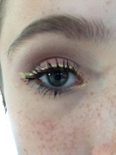 Pink shadow blended with big lashes and gold liner