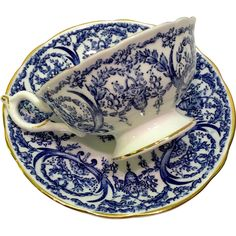 This Cobalt Blue and White Coalport Bone China Basket and Garland Teacup and Saucer is simply exquisite! The intriguing floral and basket pattern on this fine quality teacup and saucer consists Antique Dishes, Vintage Dishes, Antique China, Antique Bottles, Vintage Bottles, Vintage Perfume, Antique Glass, Blue And White China, Blue China