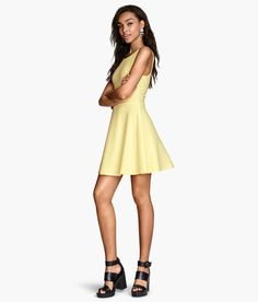 Light yellow sleeveless dress with flared skirt & low-cut V-neck back. | H&M Pastels