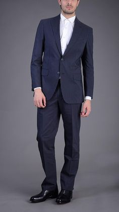 Pinstripe three button single breasted blazer with matching four pockets classic trousers. 100% cotton.