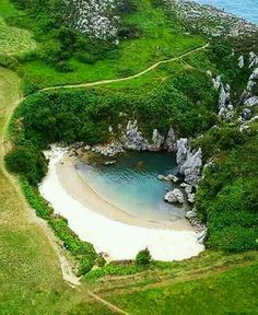 Tips: Gulpiyuri Beach, Asturias, Spain. Gulpiyuri Beach, or Playa de Gulpiyuri, is one of the most amazing tourist attractions of northern Spain. It's a small beach located in a green meadow Beaches In The World, Places Around The World, The Places Youll Go, Travel Around The World, Places To See, Around The Worlds, Asturias Spain, Spain Travel, Beautiful Beaches