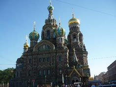 """The Church of Our Savior on Spilled Blood"" (known locally as Spas na Kravi) is a beautiful gold-draped onion-domed church on the Griboedova Canal, one of the many waterways in the old Russian capital."