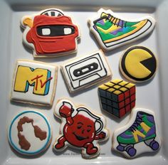 80s-themed cookie set (includes Viewmaster, high-top shoe, MTV logo, cassette tape, Pacman logo, Rubix Cube, mullet, Kool-Aid Man, and roller skate)