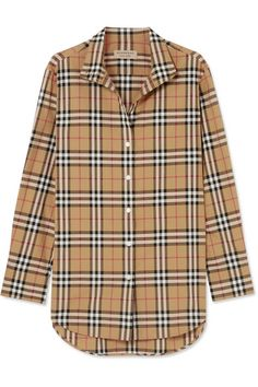 Other than a trench coat, we couldn't name anything more iconic from Burberry than its heritage check - and luckily for us the label has brought it back in a big way this season. This shirt is made from crisp cotton-poplin and updated with a mandarin-style collar. Channel the '90s and style yours with track pants and sandals.