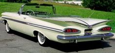 "1959 Chevrolet Impala Convertible.  My grandmother had one of these when I was a kid, except it wasn't a convertible.  I loved the tail lights & the ""V"" shaped trunk."