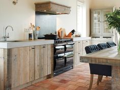 Love the contrast of the rough timbers, the luxe upholstered chairs, solid colour vs washed...