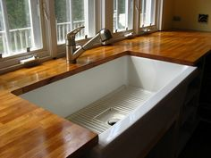 Butcher block countertop with farmhouse sink.