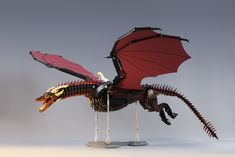 The majestic and fiery Drogon from Game of Thrones is beautifully brought to life in LEGO by Marcin Otreba, complete with the signature red wings sporting black and red scales. At perhaps a minifigure scale and built to the wingspan of 38 inches with flexible joints at the neck and tail, owning your very own …