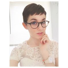 My pixie hair cut with round glasses. I get it cut super short to avoid having to get it cut too often. That was it can grow out a bit before I'm unhappy. I love my hair!
