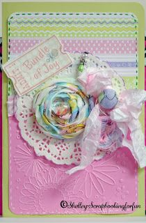 Baby card created by PINQUETTE Shelley using Pinque Peacock 3/4' Fabric Covered Button, Angel Stick Pin, Splendid Swirls Flowers.   #flower #fabricflower #pinquepeacock #babycard #card #cards #beadedstickpin #angelstickpin #fabricbutton #button #babybutton