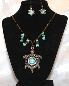 Antique gold and turquoise are used to bring these elegant turtles to life. You can find it at http://artbymichelewilson.com/sellturquoiseturtle.htm
