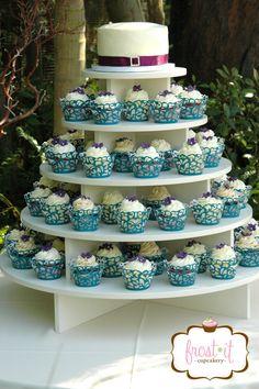 Custom wedding cupcake tower for peacock themed wedding.  #peacockwedding #weddingcupcakes