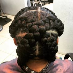 updo with criss crossed goddess braids