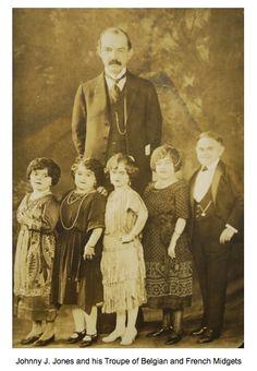 Photo of Johnny J. Jones circus impresario and his Troupe of Belgian and French Midgets. C. 1920.
