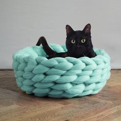 Just look at this adorable black kitty enjoying this luscious crocheted wool cat…