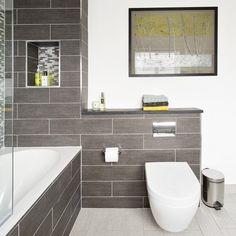 Modern bathroom with Villeroy and Boch bath, grey tiling and artwork