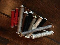 hand spun bobbins, ready for weaving