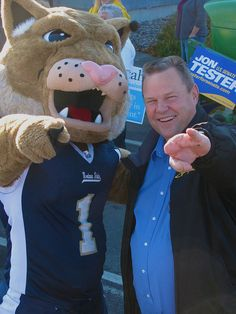 Bozeman - Jon Tester and Champ, the Montana State University Bobcat, prepare for the 2010 Homecoming Parade.