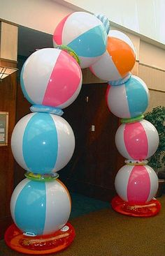 Pool Party Beach Ball Arch: Inflatable beach balls alternating with water rings - Each of these items can be purchased at the dollar store - Full instructions found here: http://www.wikihow.com/Make-a-Beach-Ball-Party-Arch