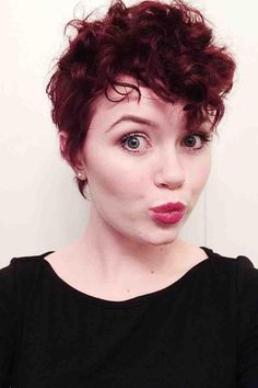 This one is fun too! a lot going on, not too much on the sides therefore around/in my face, but doesn't look like a stupid mohawk either! woo hoo! curly pixie cut before and after - Google Search