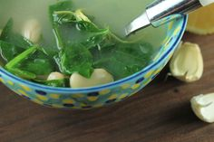 Lemon Garlic Soup with White Beans and Kale makes for a warm and healthy winter recipe. #lemongarlicsoup #souprecipes