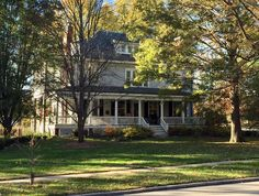 Beautiful turn- of- the-20th-century Kirkwood home. The trees have lost enough leaves to see the house behind them.