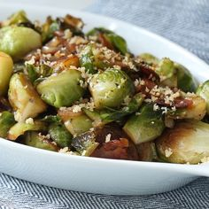Brussels Sprouts with Bacon Sautéed Brussels sprouts with bacon will be your new favorite side dish! These green sprouts are topped with crunchy breadcrumbs and served with savory hickory smoked bacon. Bacon Recipes, Vegetable Recipes, Salad Recipes, Cooking Recipes, Healthy Recipes, Brussels Sprouts Recipe With Bacon, Brussel Spouts With Bacon, Sauteed Brussel Sprouts, Sprout Recipes