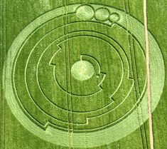Pi Crop Circle - The theory is that the circle, in a field near Barbury Castle in Wiltshire, south-west England, is a coded image of the first ten digits of pi; 3.141592654.