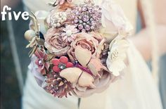 this bouquet is made up of paper/fabric flowers. too much work, but very pretty.