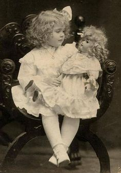 sweet girl and her look-alike doll
