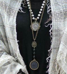 layered medallion necklaces and gauzy wrap