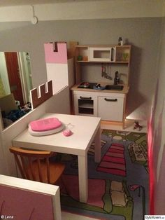 Take an IKEA Kura bunk bed and make the top a play loft!!!
