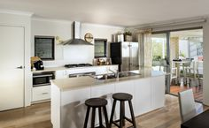 The galley kitchen includes stainless steel appliances and Caesarstone benchtops