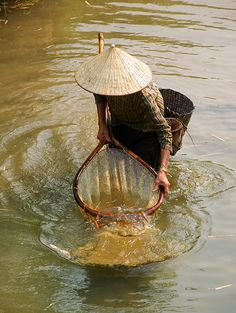 via www.mountainadventures.com Mai Chau, Vietnam. Fishing near the village of Mai Chau in Vietnam's Northwest region.
