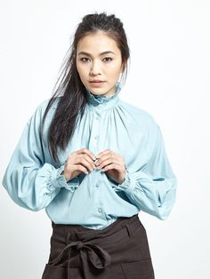 Sky blue Victorian ruffle blouse  • high neck • poet sleeves • tonal buttons Fabric Composition: 50% Polyester, 50% Rayon  Model is 173cm and wears: UK S/ EU... Ruffle Blouse, Poet, Fabric, Sleeves, Composition, How To Wear, Blue, Victorian, Buttons