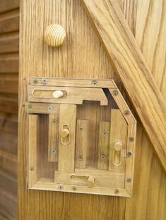 Wooden Puzzle-lock.  You could build something like this without the clear cover and cachers need to figure it out to open the geocache box.