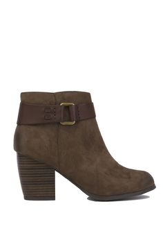 The Buckled Khaki Round Toe Heeled Booties feature a rounded toe, chunky heel, inner zipper closure, and a faux leather strap with dusted gold-toned metal detail. Free standard U.S. shipping $75+.