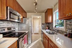 countertops and backsplash color combo with oak cabinets for the rh pinterest com