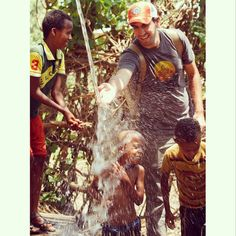 April 2, 2015: Mark Visser playing with Antsokia Valley kids at water catchment system installed in 1986; has brought new life for 300 families who drink and irrigate from it.