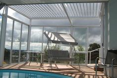 The modern Silencio Louvres by Johnson & Couzins are climate change at your fingertips, providing sun and rain protection at the touch of a button. Louvre, Shades, Living Room, Outdoor Decor, Modern, Home Decor, Trendy Tree, Decoration Home, Room Decor