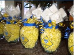 Cub Scout Blue & Gold Centerpieces... Buttered popcorn in vases