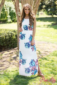 You'll look radiant in this beautiful floral maxi! This dress features a blooming floral print in shades of neon pink, blue, mint, and orange on a background of off-white fabric.