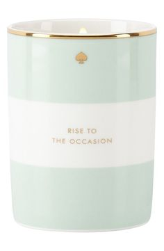 Adding a modern, sophisticated touch to any space with this macaroon-scented candle in a pastel-striped jar.
