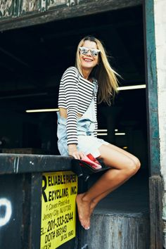 Natalie Joos in stripes, overalls, and reflective sunglasses | Tales Of Endearment