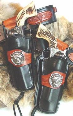 Buffalo Hunter-The Buffalo Hunter Rig combines our extended drop holsters with a classic straight-cut ranger-style belt. Cowboy Holsters, Western Holsters, Gun Holster, Leather Holster, Cowboy Action Shooting, Cool Guns, Le Far West, Guns And Ammo, Ranger